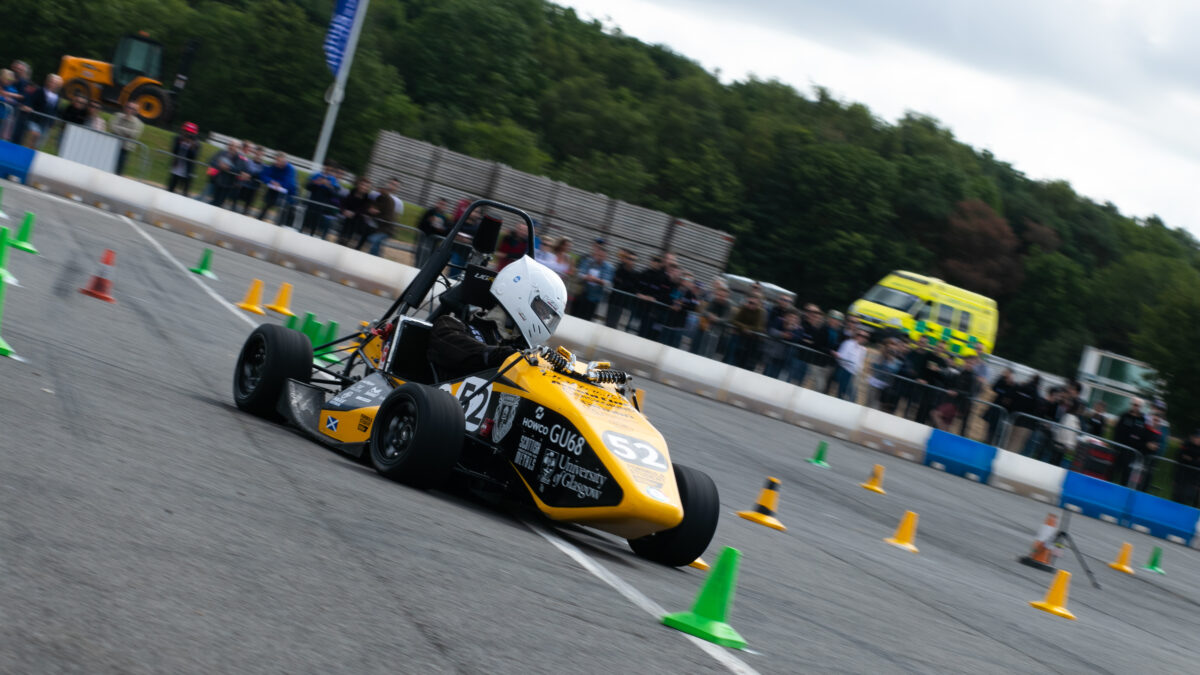 Students race for chequered flag with electric vehicle in racing competition